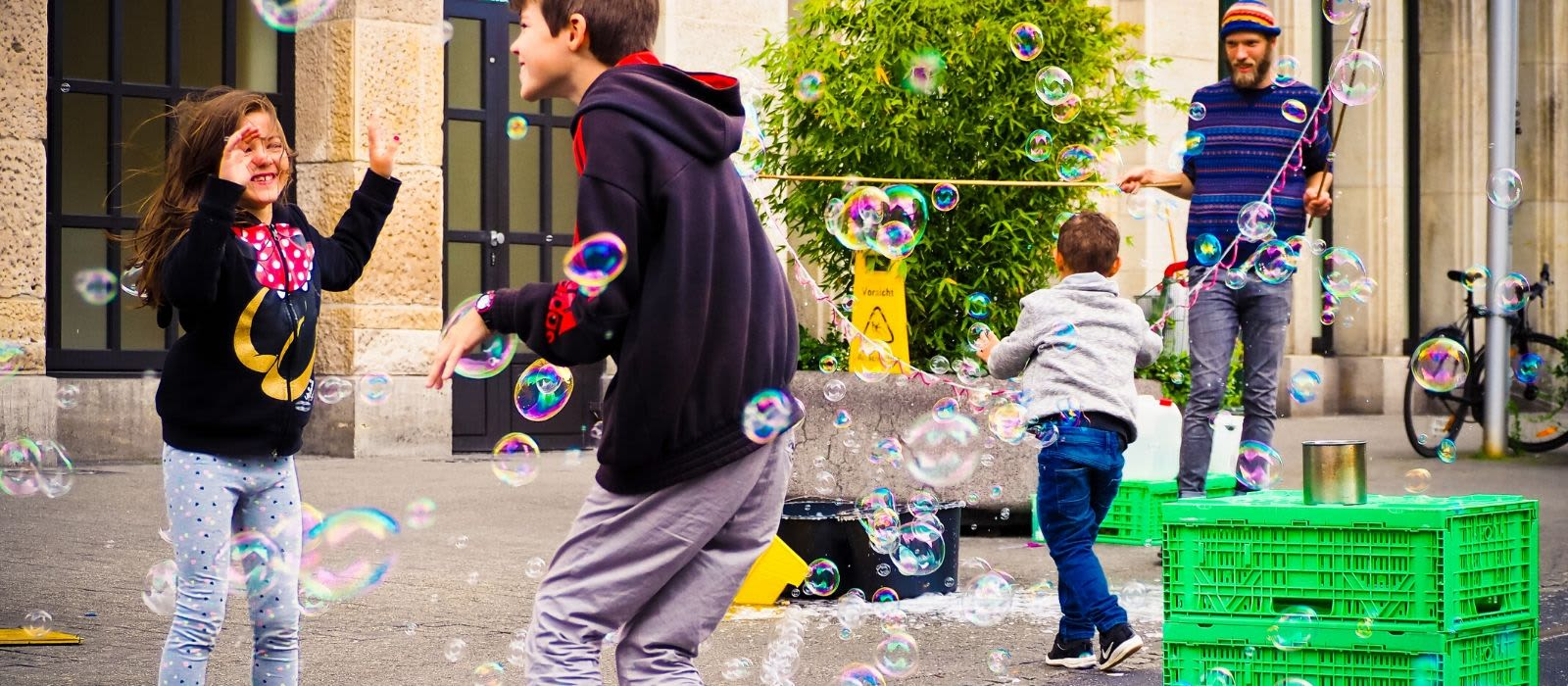 Image of teenagers playing with bubbles